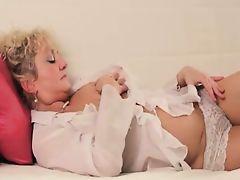Horny granny in stockings masturbating