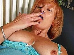 Redheaded granny with hairy pussy
