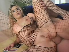 Blond in fishnets takes anal pounding