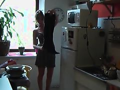 Alexia shows her kitchen in her black boots